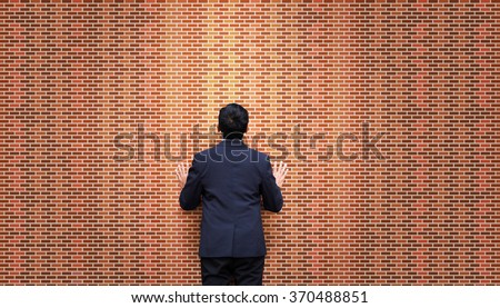 Businessman look at brick wall. Stalemate. Problem. - stock photo