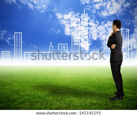 Businessman look city on skyline in future - stock photo
