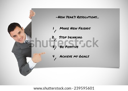 Businessman looking around the corner and is pointing against grey card - stock photo