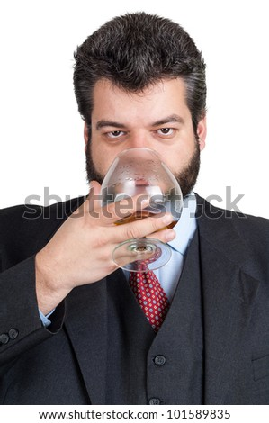 Businessman looking at a glass of whisky - stock photo