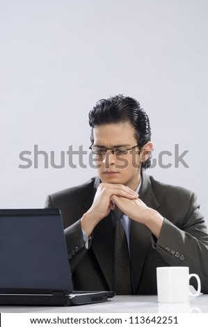 Businessman looking at a laptop - stock photo