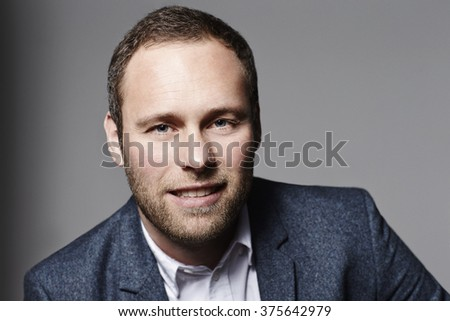 Businessman looking at camera, studio
