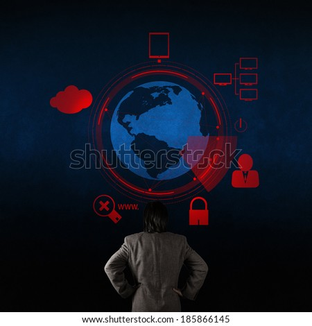 businessman looking at 3d world with padlock as Internet security online business concept  - stock photo