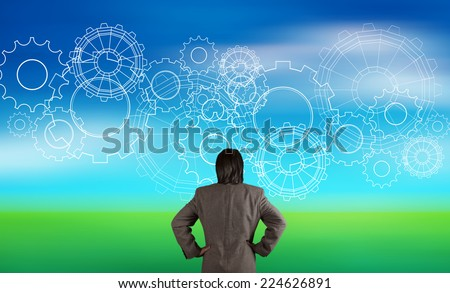 businessman looking at gear to success concept on blur nature background as concept - stock photo