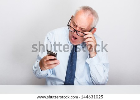 Businessman looking at his cellphone - stock photo