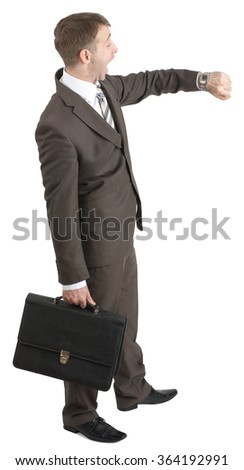 Businessman looking at his hand - stock photo