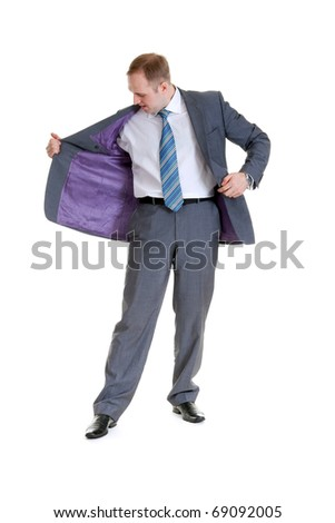 businessman looking at his jacket pocket on a white background