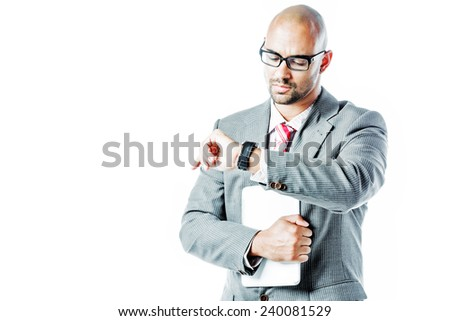 Businessman looking at his watch isolated on white - stock photo