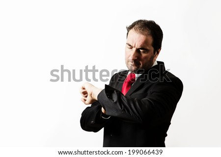 businessman looking at his watch looks like he's late