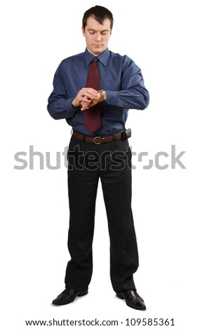 businessman looking at his watch on white background - stock photo