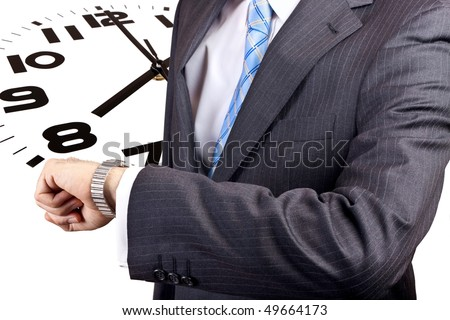 Businessman looking at his watch, waiting for something or someone - stock photo