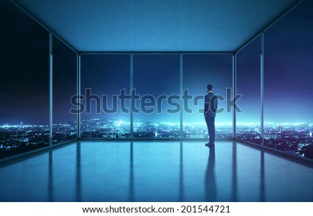 Businessman looking at night city - stock photo