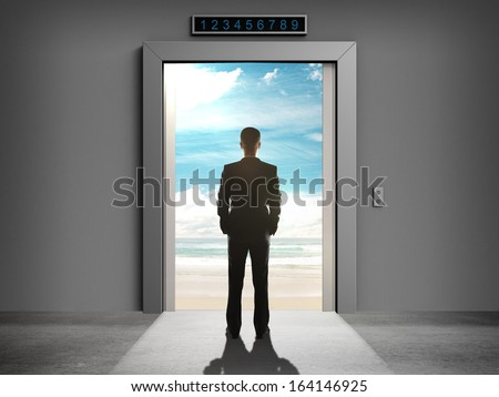 businessman looking at opened elevator - stock photo