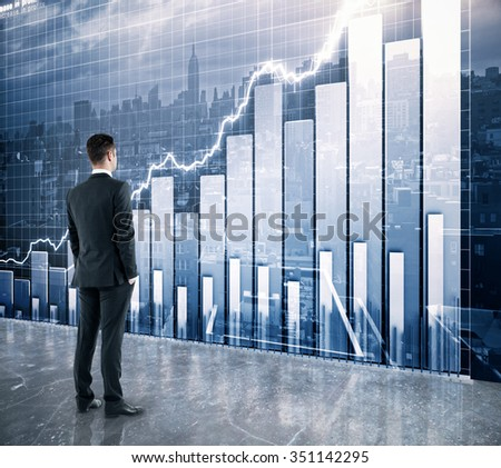 Businessman looking at the scoreboard with business chart and city view - stock photo