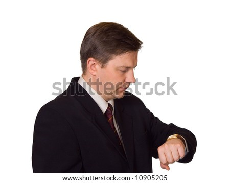 Businessman looking at watch, isolated on white background - stock photo