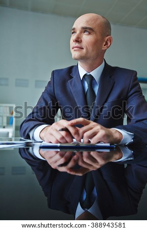 Businessman looking away to take mind off things - stock photo