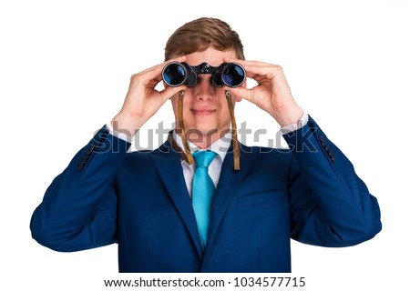 Businessman looking binoculars, blue suit isolated over white background.