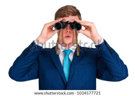 Businessman looking binoculars, blue suit isolated over white background man i shock.
