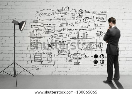 businessman looking business concept on wall - stock photo