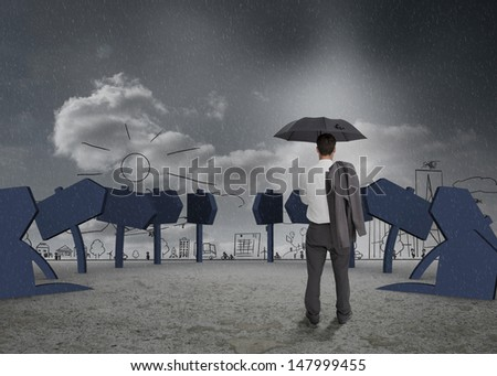 Businessman looking cityscape and signs and holding jacket and his umbrella