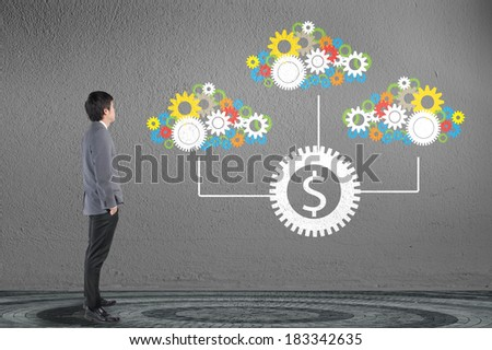 Businessman looking cloud computing network with gear and engine for money concept