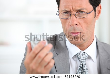 businessman looking concerned - stock photo