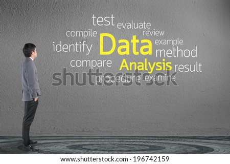 Businessman looking Data Analysis text wording in cloud concept