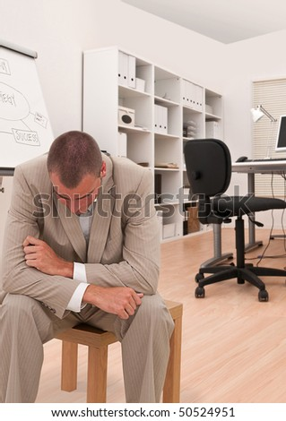 businessman looking depressed in his office - stock photo