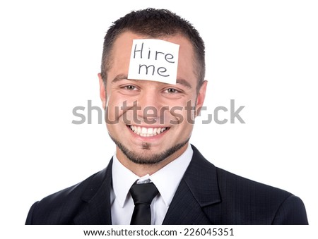 """Businessman looking for a job. Man is holding """"Hire Me!"""" Smiling. - stock photo"""