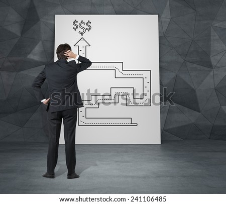 businessman looking for a way out of labyrinth to money - stock photo
