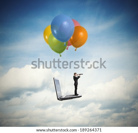 Businessman looking for new business over a laptop - stock photo
