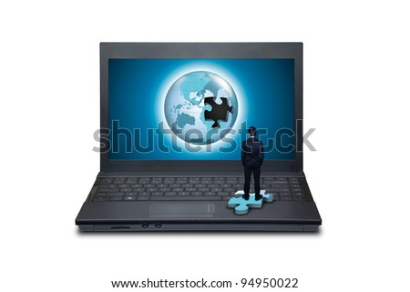 Businessman looking globe in a laptop.