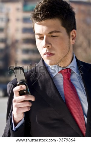 Businessman looking information at his phone - stock photo