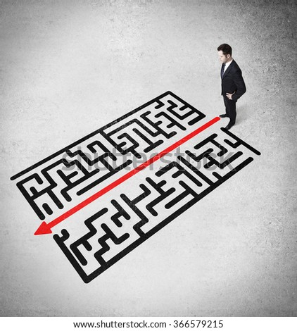businessman looking on a labyrinth, business concept - stock photo