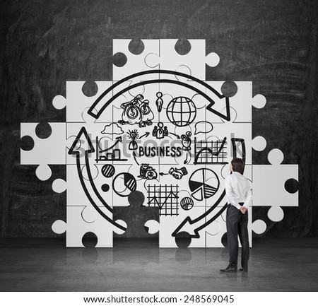 businessman looking on drawing business startegy on wall - stock photo