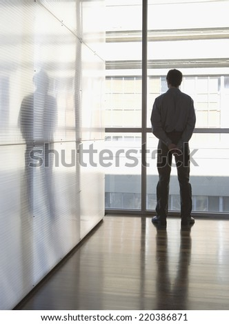 Businessman looking out the window - stock photo