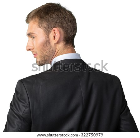 Businessman looking over his shoulder - stock photo