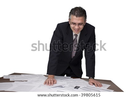 Businessman looking over the paperwork and smiling (white background)
