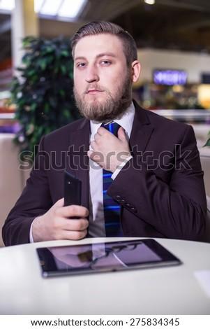 Businessman looking, phone, board, tie  - stock photo