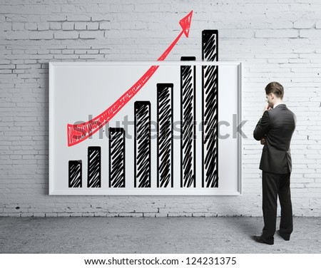 businessman looking poster with growth chart - stock photo