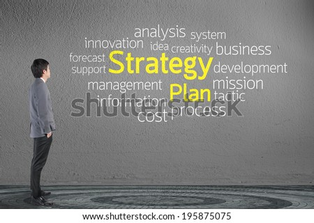 Businessman looking Strategy plan text wording in cloud concept