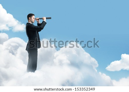 businessman looking through a telescope - stock photo