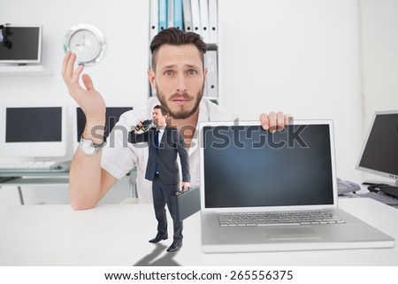 Businessman looking through binoculars against confused computer engineer looking at camera with laptop