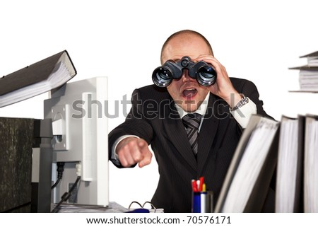 businessman looking through binoculars and pointing with finger
