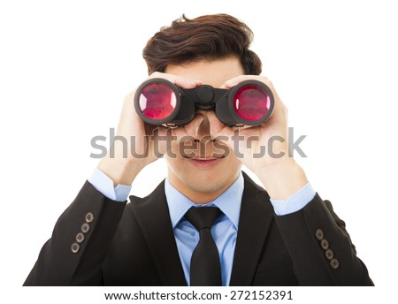 Businessman looking through binoculars and searching  - stock photo