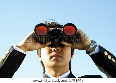 Businessman looking through binoculars, can be used for vision/prospects metaphor - stock photo
