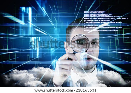 Businessman looking through magnifying glass against blue lines next to screens and text - stock photo