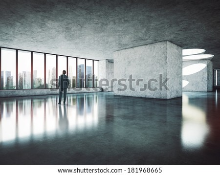 Businessman looking through the window on a city - stock photo