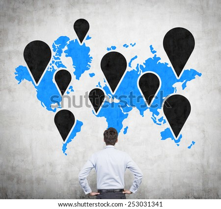 businessman looking to icons on world map - stock photo