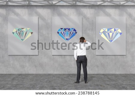 businessman looking to placard with drawing brilliants - stock photo